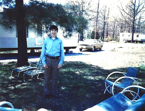 The author, in front of his tiny home, c. 1972
